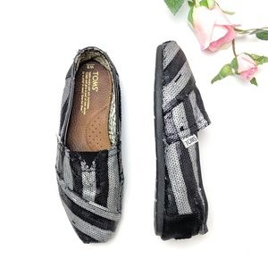 Toms sequin black and silver flats, size 8